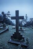 Spooky Halloween graveyard in fog Stock Image