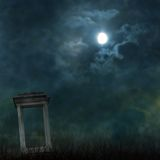Spooky Halloween graveyard with  ominous moon Stock Photography