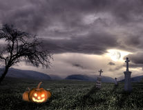 Spooky Halloween graveyard with pumpkin Stock Photography