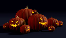 Spooky Halloween jack-o'-lanterns with evil faces glowing in the dark. 3D render of pumpkins carved into jack-o'-lanterns with frightening faces for Halloween Royalty Free Stock Image