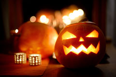 Spooky Halloween jack-o-lanterns lit at night Stock Images