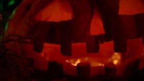 Creepy halloween pumpkin close up stock video