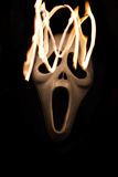 Spooky halloween mask with movement of flame Royalty Free Stock Photo