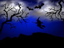Spooky halloween night. A dark, scary Halloween night scene with the silhouette of a witch on a broomstick and large bats flying through the air Stock Image