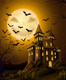 Spooky halloween night, with haunted castle Royalty Free Stock Photography