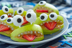 Spooky Halloween party monsters. Spooky green apple monsters for Halloween party Stock Photos