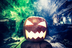 Spooky Halloween pumpkin with blue and green smoke Stock Photography