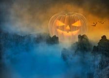 Spooky Halloween pumpkin in foggy mystical landscape royalty free stock photo
