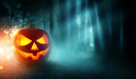 Spooky Halloween Background and Jack O Lantern royalty free stock images
