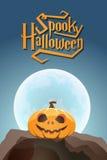 Spooky Halloween pumpkin in moon light on a rock Royalty Free Stock Photo