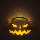 Spooky Halloween Pumpkin Shining on dark background Stock Image