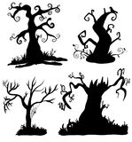 Spooky halloween trees in black. Spooky halloween black trees on white background Royalty Free Stock Images