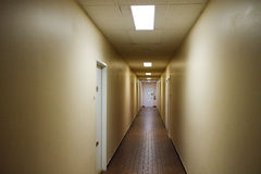 Spooky hallway in old building Stock Photo