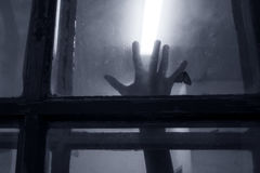 Spooky hand on the window Stock Photography