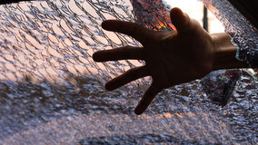 Spooky hand windshield cracked. Royalty Free Stock Photos