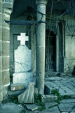 Spooky haunted building and gravestone Royalty Free Stock Image