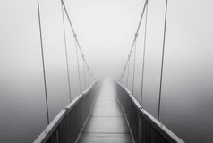 Spooky Heavy Fog on Suspension Bridge Vanishing into Creepy Unknown