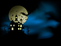 Spooky house. With an eerie night sky and bats Stock Image