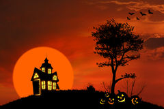 Spooky house. Halloween background with spooky house and pumpkins on the hill stock illustration
