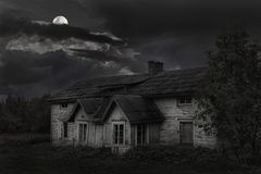 Spooky house with bright moon stock photos