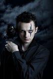 Spooky man with crow Stock Photos