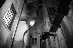 Spooky night scene with street light, stairs and smoke Royalty Free Stock Photos