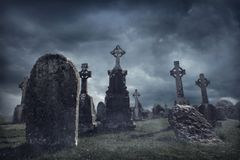 Spooky old graveyard. At night royalty free stock photography
