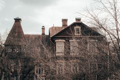 Spooky old Manor in cloudy weather. Gloomy atmosphere. royalty free stock photography