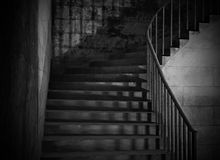 Spooky old stone interior staircase Royalty Free Stock Images