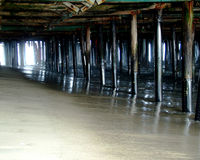 Spooky Pier Underworld. Beneath a pier in Southern California stock image