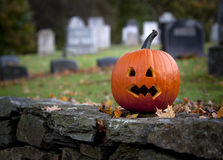 Spooky pumpkin with graveyard background Royalty Free Stock Images