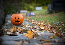 Spooky pumpkin with graveyard background. In Fall Stock Photo