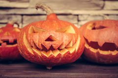 Spooky pumpkins for Halloween party on dark rustic background Stock Image
