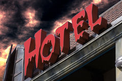 Spooky red hotel sign. With eerie sky background stock image
