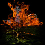 Spooky Scary Graveyard With Burining Fire and Flames Engulfing G Stock Images
