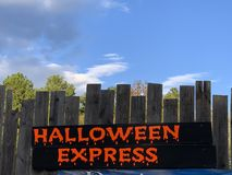 A spooky sign showing Halloween Express stock images