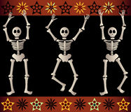 Spooky Skeletons. Three spooky skeletons jump and dance around - bordered by black and orange elements - great for Halloween or Dia de los Muertos Royalty Free Stock Photography