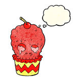 Spooky skull cupcake cartoon with thought bubble Royalty Free Stock Images