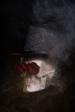 Spooky skull in tophat with red roses Royalty Free Stock Images