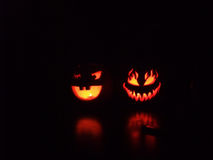 Spooky and Smiling Halloween Pumpkins royalty free stock image