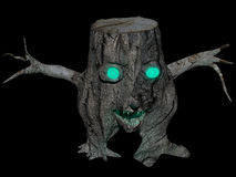Spooky stump  on black Royalty Free Stock Photography
