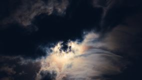 Supermoon behind clouds. Spooky super moon shines behind abstract clouds Stock Photos