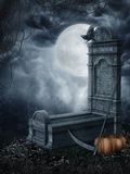 Spooky tombstone. Halloween scenery with a spooky tombstone and pumpkins royalty free illustration