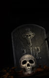 Spooky tombstone with skull on black Royalty Free Stock Image