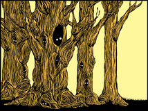 Spooky Trees. Grove of spooky trees in woodcut style with eyes peering from hollows Royalty Free Stock Photography