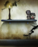 Spooky voodoo doll. A voodoo doll beside a jar of eyeballs on a shelf in a spooky candlelit room stock photo