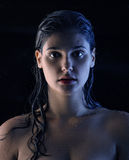 Spooky, wet, sexy women - temptation... Wet sexy girl with soft skin in front of my camera Royalty Free Stock Photography