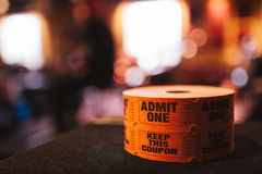 Spool Of Admit One Tickets. Spool of admit one orange tickets stock images