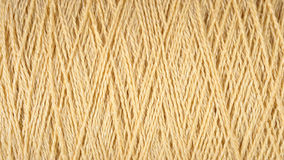 Spool of beige thread macro background Royalty Free Stock Photography
