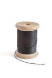 Spool with black thread. On white background Stock Images